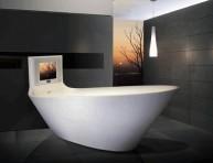 imagen Saturno, la bañera y Tv todo en uno