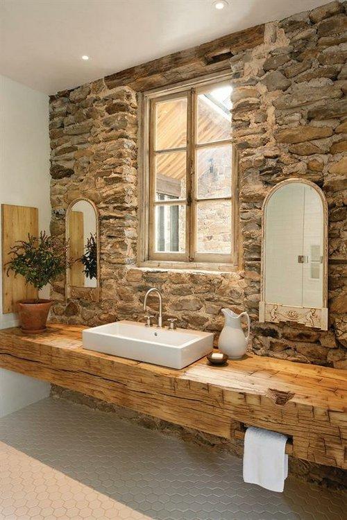 Cuartos de ba o sobre piedra natural for Banos de piedra natural