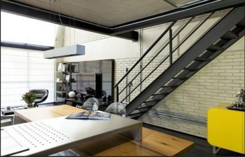 Loft moderno con elementos metálicos 3