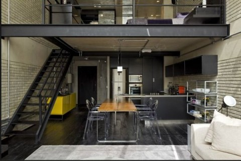 Loft moderno con elementos metálicos 6