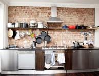 imagen La cocina de estilo industrial y las paredes de ladrillo visto