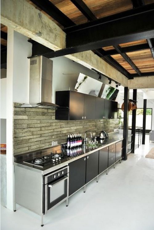 Naturaleza y minimalismo en una casa en kuala lumpur for Casa minimalista industrial