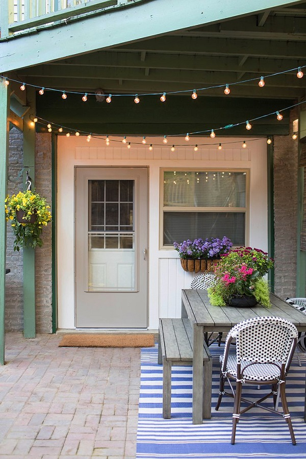 10 consejos simples para decorar tu patio este verano for Luces patio exterior
